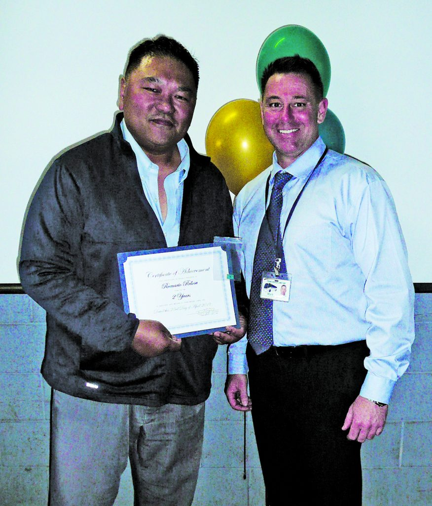 Romario Relosa, left, receives his certificate for 2 years of safe driving. Presenting Romario's certificate is Trans-Bridge Lines Director of Operations Mark Ertel.