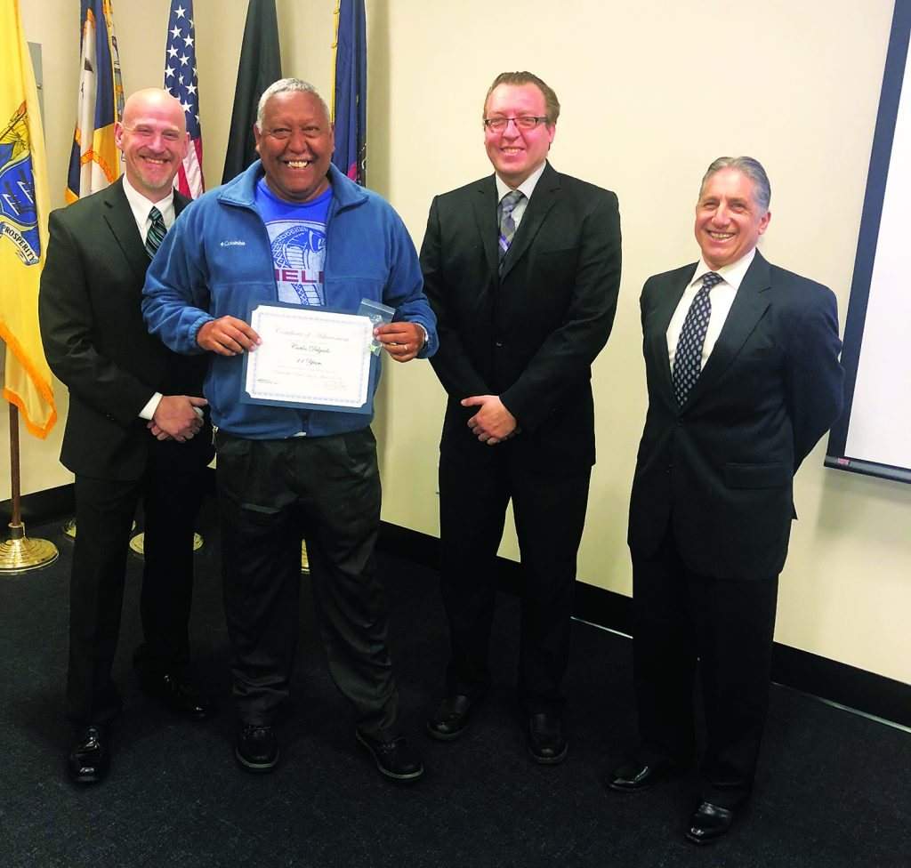 From left: Safety and Training Supervisor Brendan Stanczyk, Safety and Training Manager Scott Clark, Motorcoach Driver Carlos Delgado and President Tom JeBran. Delgado received congratulations and was presented with his certificate and engraved pin for 11 safe years.